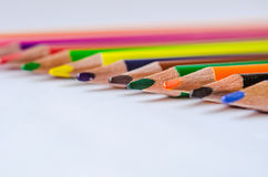 Colored pencils on white background. Set of colored pencils isolated against the white background. Close up, right to left, space for text, selective focus Stock Photo