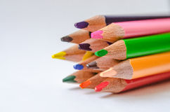 Colored pencils on white background. Set of colored pencils isolated against the white background. Close up, right to left, space for text, selective focus Stock Photography