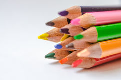 Colored pencils on white background. Set of colored pencils isolated against the white background. Close up, right to left, space for text, selective focus Royalty Free Stock Photo