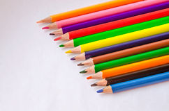 Colored pencils on white background. Set of colored pencils isolated against the white background. Close up, right to left, space for text, top view Stock Photos