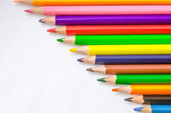 Colored pencils on white background. Set of colored pencils isolated against the white background. Close up, right to left, space for text, top view Royalty Free Stock Images