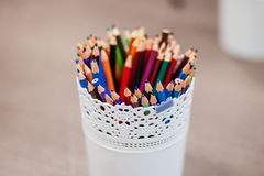 Colored pencils. In a white bucket. Close-up stock photo