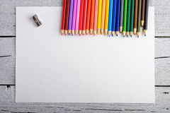 Colored pencils on white old wooden background. Top view. Royalty Free Stock Images