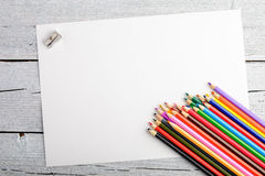 Colored pencils on white old wooden background. Top view. Stock Photos