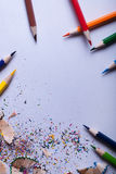 Colored pencils on white paper Royalty Free Stock Images