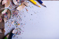 Colored pencils on white paper Royalty Free Stock Photos