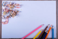 Colored pencils on white paper Royalty Free Stock Photography