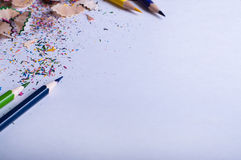 Colored pencils on white paper Royalty Free Stock Image