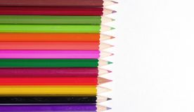 Colored pencils on white paper Stock Photos