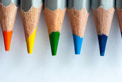 Colored pencils on a white piece of paper. Sharpened colored pencils. Ready to paint. Stock Photos