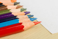 Colored pencils and white sheet. Horisontal shot Royalty Free Stock Photography