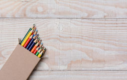 Colored Pencils on White Table Stock Images