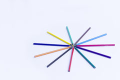 Colored pencils. On white table. Space for text Stock Photos