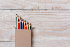Colored Pencils on White Wood Table Royalty Free Stock Photography