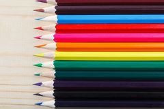 Colored pencils on wood background with space for your text royalty free stock photos