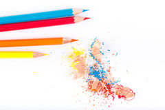 Colored pencils and wood chips Royalty Free Stock Photography