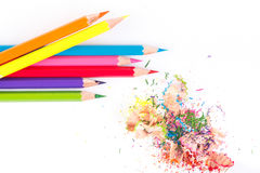 Colored pencils and wood chips Royalty Free Stock Photos