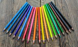 Colored pencils on wooden background Royalty Free Stock Photography