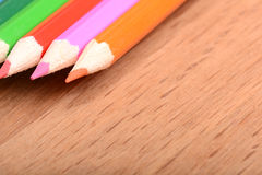 Colored pencils  on wooden background Stock Photography