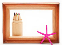 Colored pencils in a wooden frame. Stock Photography