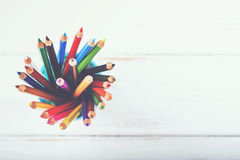 Colored pencils. On a wooden table Stock Image