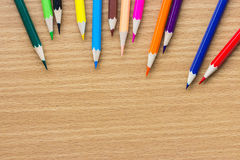 Colored pencils on the wooden table Royalty Free Stock Photos