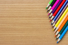 Colored pencils on the wooden table Royalty Free Stock Photo
