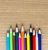 Colored pencils on the wooden table Royalty Free Stock Photography