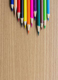 Colored pencils on the wooden table Stock Image