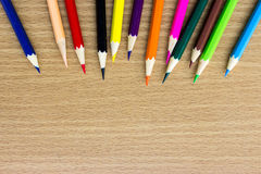 Colored pencils on the wooden table Royalty Free Stock Images