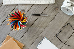 Colored Pencils On Wooden Table In A Designer Home Office Stock Photo