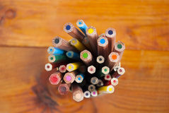 Colored pencils on a wooden table Royalty Free Stock Image