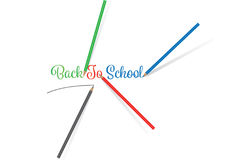 Colored Pencils writing BACK TO SCHOOL. 4 Colored Pencils writing BACK TO SCHOOL on a white background Royalty Free Stock Photos