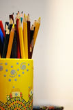 Colored pencils. In yellow weight near other . Weight with house and smoke Royalty Free Stock Image