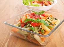 Colored penne pasta Stock Images