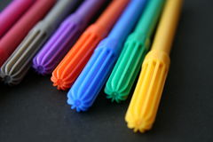 Colored pens. Set on black background Stock Photos