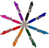 Colored pens in a circle Royalty Free Stock Images
