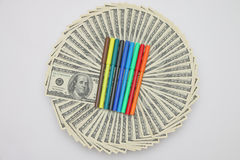 Colored pens for coloring dollar bills. Royalty Free Stock Image