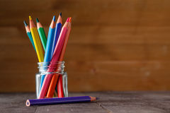 Colored pens in glass Stock Images