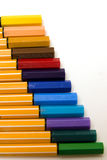 Colored pens on ladder Royalty Free Stock Photography