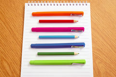 Colored pens on a notepad Stock Photo