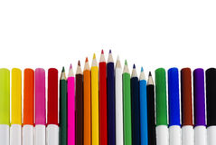 Colored Markers And Pencils Arranged In A Horizontal and Triangular Pattern Royalty Free Stock Photo