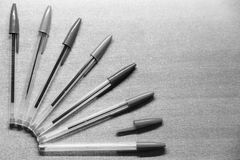 Colored pens. Some colored pens illuminate in black and white photo royalty free stock photos