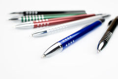 Colored pens on white table stock photography