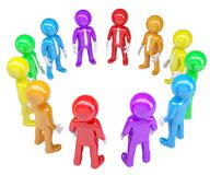 Colored people stood in a circle Stock Photos