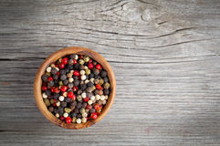 Colored Pepper in the wooden bowl Stock Photography