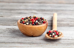 Colored Pepper in the wooden bowl Royalty Free Stock Photo