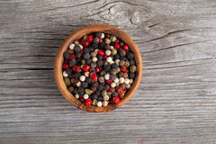 Colored Pepper in the wooden bowl Royalty Free Stock Photos