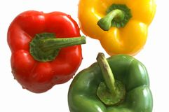 Colored peppers. Three colored peppers, isolated on a white background Royalty Free Stock Photography