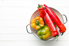 Colored peppers in colander Royalty Free Stock Images